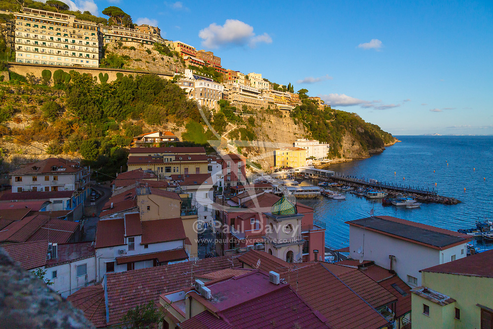 Sorrento, Italy, September 15 2017. Cliff edge hotels and buildings overlook Marina Grande in Sorrento, Italy. © Paul Davey