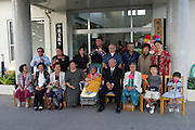 Birthday celebrant has her photograph taken with her family at an Ogimi Village area nursing home in Okinawa, Japan. Most of the community has turned out to honor the birthdays of three residents. (These are traditional Japanese birthdays, not the actual birth dates. 88, for example is celebrated on the eighth day of the eighth month in the lunar calendar.) Musicians, dancers, and comedians perform as well wishers cheerfully gorge on sushi, fruits, and desserts. (Supporting image from the project Hungry Planet: What the World Eats).