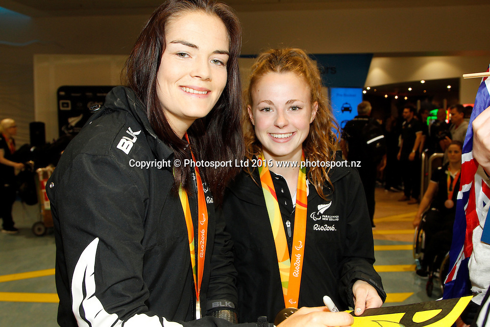 Holly Robinson and Anna Grimaldi.<br /> The New Zealand Rio 2016 Paralympic Team arrives at Auckland airport this morning to be greeted by families and well wishers. Copyright photo Dave Mackay / photosport.nz