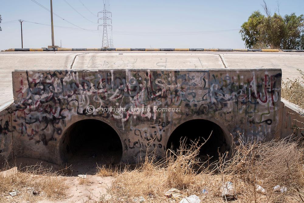 Libya: Culvert where Moammar Gaddafi was captured in Sirte. Alessio Romenzi