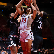 09 November 2018: San Diego State Aztecs forward Baylee Vanderdoes (34) is fouled while attempting to take a shot under the basket by two Hawaii defenders. The Aztecs opened up it's regular season schedule with a 58-57 win over Hawaii Friday at Viejas Arena.