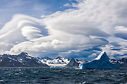 Lenticular clouds above rugged mountains, South Georgia, South Atlantic Ocean
