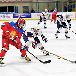 WHITBY, - Dec 17, 2015 -  Game #10 - United States vs. Russia at the 2015 World Junior A Challenge at the Iroquois Park Recreation Complex, ON.  Ivan Kosorenkov #37 of Team Russia passes the puck past Ryan Zuhlsdorf #5 of Team United States during the first period.<br /> (Photo: Shawn Muir / OJHL Images)