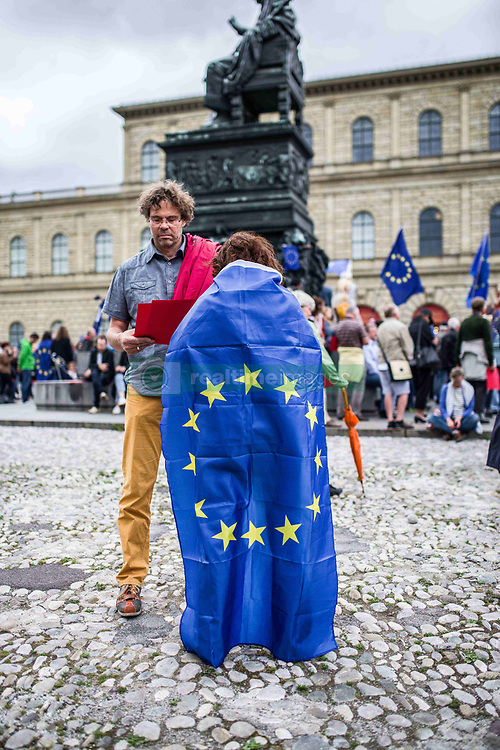 "June 4, 2017 - MüNchen, Bayern, Germany - Pro-EU demonstrators with the Frankfurt-based Pulse of Europe #pulseofeurope demonstrated in Munich the day after coordinated, suspected terror attacks that took place in London, England the night before.  There was little spoken of the London terror attacks, outside of a few sentences by John Friedmann, grounder of the Munich chapter after which the music and dancing program resumed.  Post-Brexit Britain has been a target of negative commentary by the Pulse of Europe movement..The Pulse of Europe movement was created to unify Europe and raise the voice of pro-EU supporters in the face of riding populism and right-radicalism.  Despite this, Pulse of Europe has explicitly welcomed Pegida members and right-radicals, as well as being criticized for what appears to be ""left-populism"" that attempts to generate European unity through the channeling and normalization of the hatred of Russia, Turkey, post-Brexit Britain, and the United States.  Further criticisms blast the large amount of program materials being based on the United States and Trump and lack of concrete discussion based on Europe. (Credit Image: © Sachelle Babbar via ZUMA Wire)"
