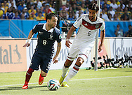 Mathieu Valbuena of France (L) and Sami Khedira of Germany (R) during the 2014 FIFA World Cup match between France and Germany at the Maracana Stadium, Rio de Janeiro<br /> Picture by Andrew Tobin/Focus Images Ltd +44 7710 761829<br /> 04/07/2014