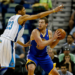 Mar 18, 2013; New Orleans, LA, USA; New Orleans Hornets power forward Anthony Davis (23) guards Golden State Warriors power forward David Lee (10) during the first quarter a game at the New Orleans Arena. The Warriors defeated the Hornets 93-72. Mandatory Credit: Derick E. Hingle-USA TODAY Sports