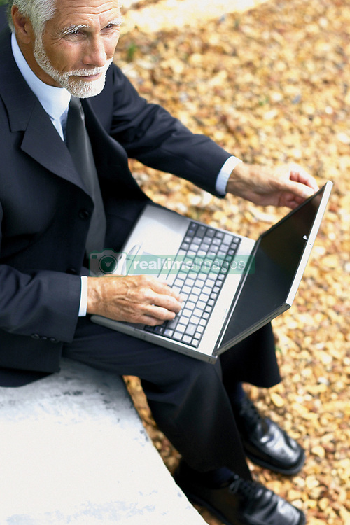 Dec. 05, 2012 - Businessman with computer (Credit Image: © Image Source/ZUMAPRESS.com)