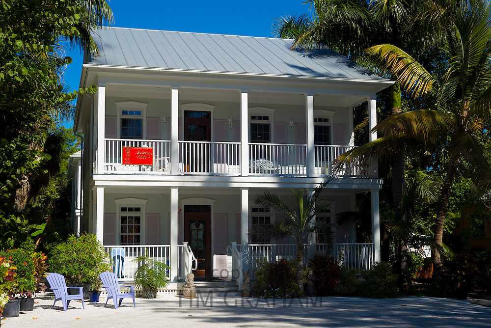 Luxury, stylish, house with adirondack chairs and palm trees of Shirley Allen Art Gallery downtown Captiva Island in Florida, USA