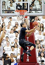 Vanderbilt's Matthew Fisher-Davis (5) drives the baseline for a basket against Texas A&M during the first half of an NCAA college basketball game, Saturday, March 5, 2016, in College Station, Texas. Texas A&M won 76-67. (AP Photo/Sam Craft)