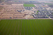 Subdivision infrastructure next to agricultural land in Phoenix, AZ