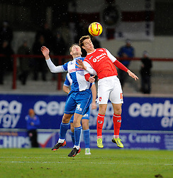 Bristol Rovers' Ollie Clarke challenges for the ball with Morecambe's Andrew Fleming - Photo mandatory by-line: Dougie Allward/JMP - Tel: Mobile: 07966 386802 14/12/2013 - SPORT - Football - Morecombe - Globe Arena - Morecombe v Bristol Rovers - Sky Bet League Two