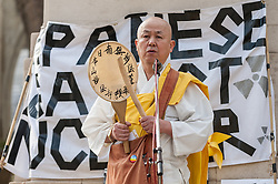 © Licensed to London News Pictures. 12/03/2016. London, UK.  The Reverend Nagase, a senior Buddhust monk from the Battersea Park Peace Pagoda, offers prayers at a rally held outside the Houses of Parliament in Westminster to recognise the fifth anniversary of the Fukushima nuclear disaster in Japan and to protest against the Japanese government's plans to restart the Sendai nuclear plant. Photo credit : Stephen Chung/LNP