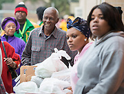 A Sunnyside resident smiles as he receives a food donation from student volunteers at Worthing High School, November 22, 2013.