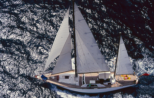 Stock photo of an aerial view of a sailboat on the water