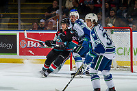 KELOWNA, CANADA - OCTOBER 23: Leif Mattson #28 of the Kelowna Rockets looks for the pass while checked by Andrew Fyten #26 of the Swift Current Broncos during second period on October 23, 2018 at Prospera Place in Kelowna, British Columbia, Canada.  (Photo by Marissa Baecker/Shoot the Breeze)