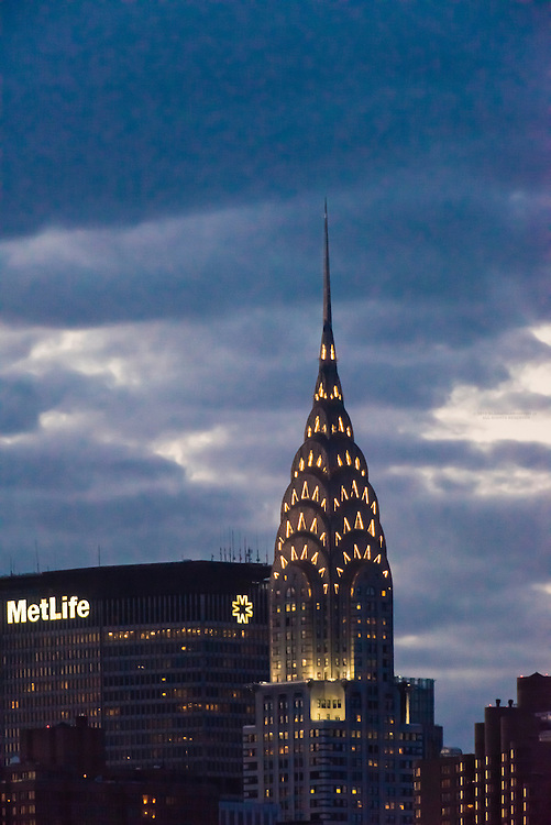 The Met Life Building and the iconic art deco Chrysler Building at twilight, New York, New York USA.