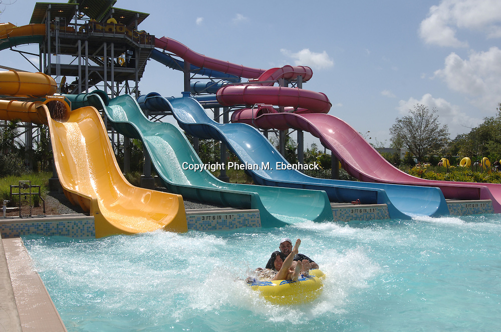 Park guests make their way down the Whanau Way ride at Sea World's new waterpark Aquatica in Orlando, Florida..