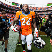 Denver Broncos free safety Darian Stewart (26) walks during an NFL regular season game against the Baltimore Ravens on Sunday, Sept. 13, 2015 in Denver. The Broncos won the game, 19-13. (Ric Tapia via AP)