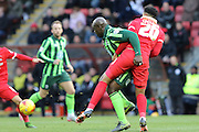 Bayo Akinfenwa of AFC Wimbledon and Cole Kpekawa of Leyton Orient tussles during Sky Bet League 2 match between Leyton Orient and AFC Wimbledon at the Matchroom Stadium, London, England on 28 November 2015. Photo by Stuart Butcher.