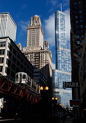 A CTA train goes through the downtown Loop as the Trump international hotel and tower building is visible behind