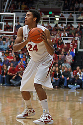 Dec 29, 2011; Stanford CA, USA;  Stanford Cardinal forward Josh Huestis (24) holds the ball against the UCLA Bruins during the first half at Maples Pavilion.  Stanford defeated UCLA 60-59. Mandatory Credit: Jason O. Watson-US PRESSWIRE
