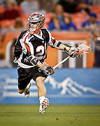 DENVER, CO - MAY 18: Drew Snider #23 of the Denver Outlaws looks for his shot while playing against against the Rochester Rattlers during their game at Sports Authority Field at Mile High May 18, 2013 in Denver, Colorado. The Denver Outlaws won the game 20-7. (Photo by Marc Piscotty/Getty Images) *** Local Caption *** Drew Snider