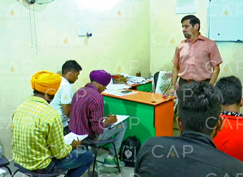 HARYANA, INDIA - SEPTEMBER, 2016: Pradeep Arora, 40, giving a lecture to his students at Eponymous Coaching Centre in the Karnal district of Haryana, India. <br />