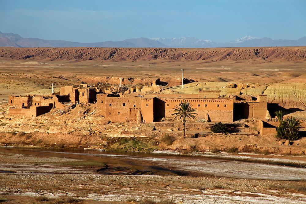 Africa, Morocco, Ouarzazate. Small traditional ksar along the Ounila River.