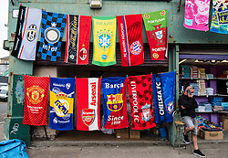 Stall selling football team towels at Barras Market in Gallowgate, Glasgow, united Kingdom