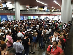 September 11, 2017 - Rio De Janeiro, Rio de Janeiro, Brazil - Hundreds of people waiting in line inside a subway station in Rio de Janeiro, Brazil, September 11, 2017 to pick up the tickets purchased through the internet for Rock Festival. With 700,000 tickets sold for the 7 days of the festival, Rock in Rio will increase the Rio de Janeiro economy. (Credit Image: © Luiz Souza/NurPhoto via ZUMA Press)