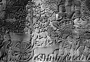 Cambodia.<br /> Bayon temple relief showing bullock cart.<br /> Angkor.  November 2001