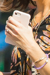 """EXCLUSIVE: ***NO WEB UNTIL 2PM EST NOV 1*** Katie Holmes wears a diamond engagement ring as she steps out for a coffee, but it seems she's not engaged to long-time boyfriend Jamie Foxx. A smiling Holmes looked relaxed and radiant as she openly flashed her bling as she went for a coffee with fellow actor Jerry O'Connell. Katie and Jerry co-star in a feature-film adaptation of the self-help best-seller 'The Secret.' The pictures were taken the day before filming started in New Orleans. But her publicist later insisted: """"Katie's not engaged to anyone besides her fictional movie fiancé, played by Jerry O'Connell."""" Holmes, who divorced 'Top Gun' star Tom Cruise in 2012, was later spotted chatting happily with Foxx, who she's believed to have been dating for five years. Foxx is currently also in New Orleans filming his latest movie, 'Power,' co-starring Joseph Gordon-Hewitt. Foxx and Dawson's Creek alum Holmes looked very much in love - the word 'LOVE' was even written on Katie's handbag. Holmes had changed into a black and white jumpsuit before the two went for a evening shop at Michael's craft store - but the actress kept her hands firmly buried in her pockets, so it's not known if she was still wearing the 'prop' ring. Foxx, 50, and Holmes, 39, went pubslic in April during a PDA-packed beach outing on a Malibu beach after shying away from getting cozy together in public for years. The very private couple have reportedly been dating since being spotted dancing together at the Hamptons a year after the Dawson Creek star's highly-publicised separation from Cruise. They have taken extraordinary measures to keep their relationship secret amid claims Katie's ex-husband included a clause in her 2012 divorce settlement banning her from publicly dating for five years. The actress split from Top Gun superstar in 2012 after six years. Their romance was one the Hollywood's biggest headline makers after they got engaged in 2005 after just seven we"""