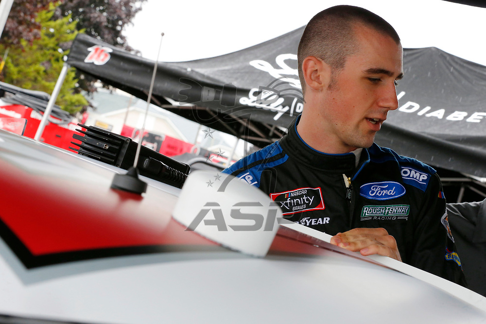Austin Cindric (60) hangs out in the garage during practice for the Zippo 200 at Watkins Glen International in Watkins Glen, New York.