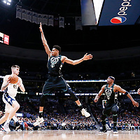 01 April 2018: Milwaukee Bucks forward Giannis Antetokounmpo (34) defends on Denver Nuggets forward Juan Hernangomez (41) next to Milwaukee Bucks guard Jason Terry (3) and Denver Nuggets guard Torrey Craig (3) during the Denver Nuggets 128-125 victory over the Milwaukee Bucks, at the Pepsi Center, Denver, Colorado, USA.