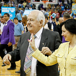 April 19, 2012; New Orleans, LA, USA; New Orleans Hornets and Saints owner Tom Benson and his wife Gayle Benson walk off the court following a win over the Houston Rockets at the New Orleans Arena. The Hornets defeated the Rockets 105-99.   Mandatory Credit: Derick E. Hingle-US PRESSWIRE