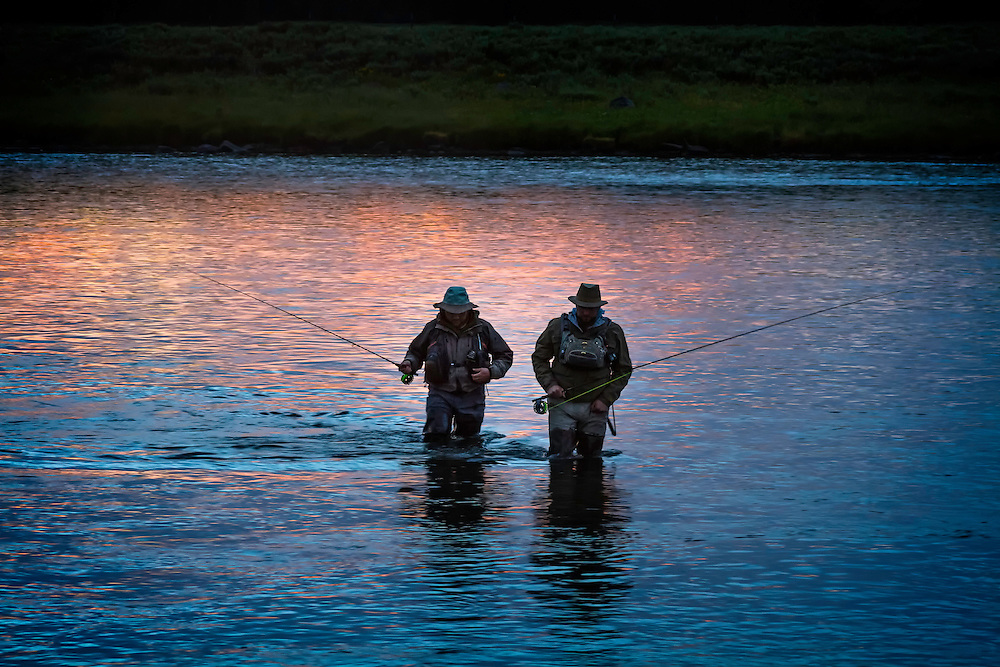 Two fly fisherman call it a day and begin the wade across the Henry's Fork River near Last Chance, ID.
