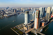 Nederland, Zuid-Holland, Rotterdam, 18-02-2015; skyline en binnenstad van Rotterdam, gezien vanaf de Kop van Zuid en de Wilhelminapier. Op de Wilhelminakade Hotel New York tussen het World Port Center (Havenbedrijf Rotterdam) en Montvideo (rechts). In de achtergrond de Erasmusbrug, De Rotterdam en New Orleans. <br /> Newly developed cultural center Kop van Zuid, urban renewal and modern architecture, high rise in a former harbour area<br /> luchtfoto (toeslag op standard tarieven);<br /> aerial photo (additional fee required);<br /> copyright foto/photo Siebe Swart