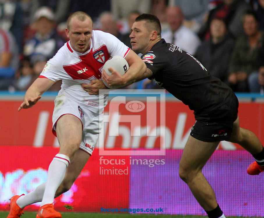 Dan Sarginson  (L) of England on the attack against Shaun Kenny-Dowall (R) of New Zealand during the 2016 Ladbrokes Four Nations match at the John Smiths Stadium, Huddersfield<br /> Picture by Stephen Gaunt/Focus Images Ltd +447904 833202<br /> 29/10/2016