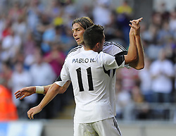 "Swansea City's Michu celebrates with Swansea City's Pablo Hernandez  - Photo mandatory by-line: Joe Meredith/JMP - Tel: Mobile: 07966 386802 22/08/2013 - SPORT - FOOTBALL - Liberty Stadium - Swansea -  Swansea City V Petrolul Ploiesti - Europa League Play-Off EDITORIAL USE ONLY. No use with unauthorised audio, video, data, fixture lists, club/league logos or ""live"" services. Online in-match use limited to 45 images, no video emulation. No use in betting, games or single club/league/player publications"