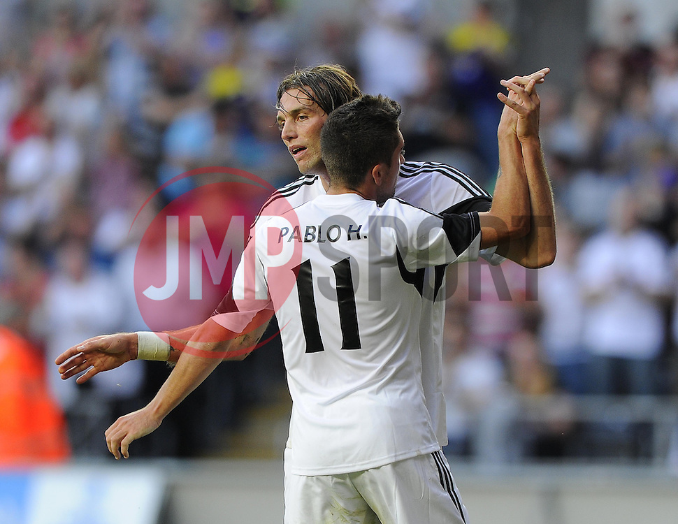 """Swansea City's Michu celebrates with Swansea City's Pablo Hernandez  - Photo mandatory by-line: Joe Meredith/JMP - Tel: Mobile: 07966 386802 22/08/2013 - SPORT - FOOTBALL - Liberty Stadium - Swansea -  Swansea City V Petrolul Ploiesti - Europa League Play-Off EDITORIAL USE ONLY. No use with unauthorised audio, video, data, fixture lists, club/league logos or """"live"""" services. Online in-match use limited to 45 images, no video emulation. No use in betting, games or single club/league/player publications"""