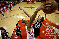 Houston Rockets forward Trevor Ariza (1) dunks over San Antonio Spurs center Pau Gasol (16) during the second half in Game 3 of an NBA basketball second-round playoff series, Friday, May 5, 2017, in Houston. San Antonio won the game 103-92. (AP Photo/Eric Christian Smith)