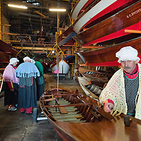 VENICE, ITALY - JANUARY 06:  Rowers prepare their boats inside the Bucintoro rowing clubahead of the 34th  Befana Regata on January 6, 2012 in Venice, Italy.  In Italian folklore, Befana is an old woman who delivers gifts to children throughout Italy on the feast of the Epiphany on January 6 in a similar way to Saint Nicholas or Santa Claus.