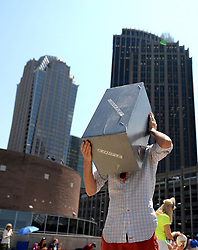 Jackson Doeler of Charlotte, N.C. checks out the solar eclipse through a pin hole in a box atop the Discovery Place parking deck on Monday, Aug. 21, 2017 in Charlotte, N.C. Photo by Jeff Siner/Charlotte Observer/TNS/ABACAPRESS.COM