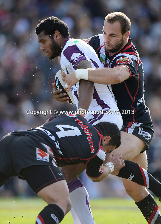 Simon Mannering tackles Sisa Waqa. NRL Rugby League match, Vodafone Warriors v Melbourne Storm at Mt Smart Stadium in Auckland on Sunday 28 July 2013. Photo: Andrew Cornaga/Photosport.co.nz