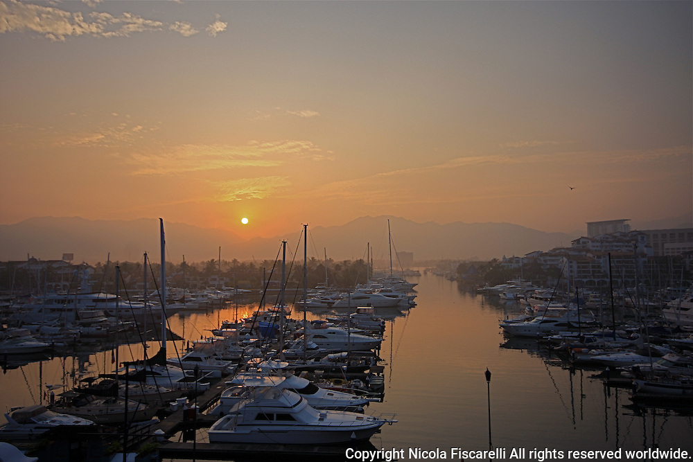 An early morning sun rise in Puerto vallarta  marina Mexico.