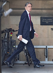 © Licensed to London News Pictures. 03/04/2019. London, UK. Chancellor Philip Hammond walks to the House of Commons for Prime Minister's Questions. Prime Minister Theresa May has called for talks with Labour Party Leader Jeremy Corbyn to seek a way forward with the Brexit deadlock. Photo credit: Peter Macdiarmid/LNP