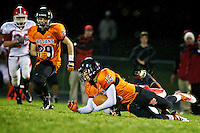 Post Falls High's Marcus Colbert falls on a ball that was rolling down the field in the second quarter after a Sandpoint High punt.