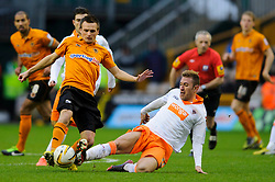 Wolves Midfielder Slawomir Peszko (POL) is tackled by Blackpool Midfielder Angel (ESP) during the second half of the match - Photo mandatory by-line: Rogan Thomson/JMP - Tel: Mobile: 07966 386802 26/01/2013 - SPORT - FOOTBALL - Molineux Stadium - Wolverhampton. Wolverhampton Wonderers v Blackpool - npower Championship.