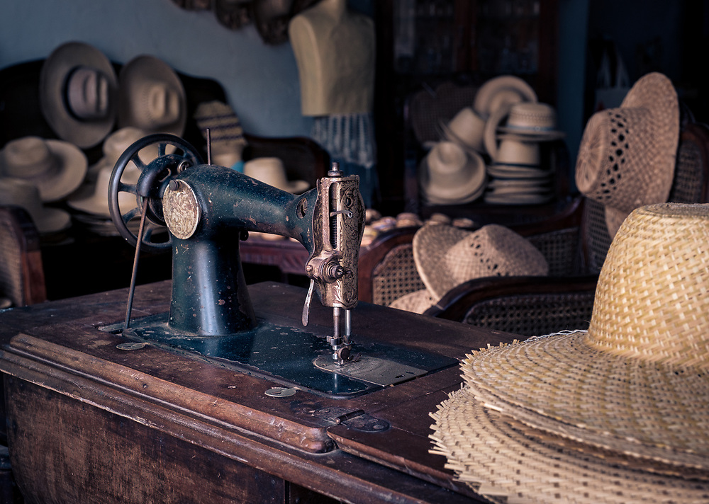 TRINIDAD, CUBA - CIRCA JANUARY 2020: Old sewing machine in hats in Trinidad