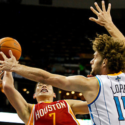 Jan 9, 2013; New Orleans, LA, USA; Houston Rockets point guard Jeremy Lin (7) shoots over New Orleans Hornets center Robin Lopez (15) during third quarter of a game at the New Orleans Arena. The Hornets defeated the Rockets 88-79. Mandatory Credit: Derick E. Hingle-USA TODAY Sports